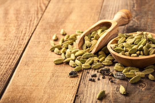 Green cardamom on wooden table