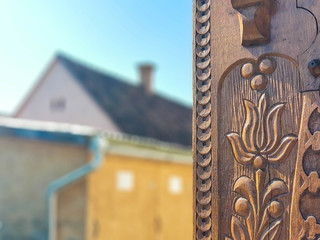 Detailed hand carved   tulip on traditional hungarian oak wood gate pylon .