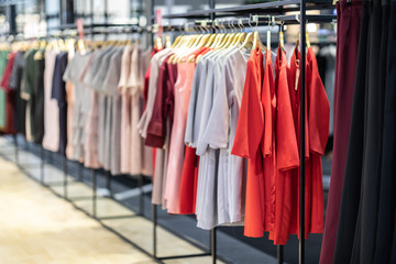 Colorful of luxury Clothes hang on a shelf in Clothes store,Selective focus,Beauty and fashion concept