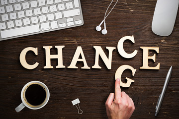 "Hand changes one of six letters, turning the word ""change"" to ""chance"""