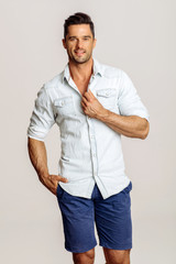 Handsome Male Model Isolated On Gray