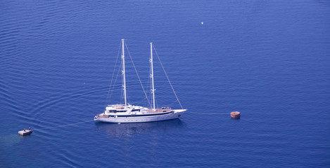 Yacht anchored to shore in Greece, Santorini Island