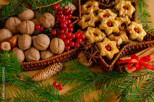 Traditional Christmas snacks walnuts and cookies with festive ...