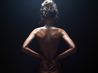 nude body girl in studio. Naked woman back