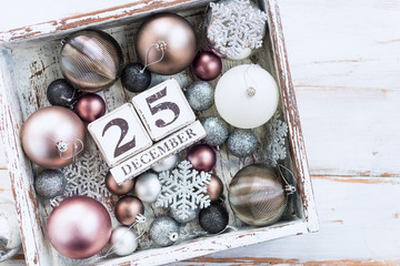 Christmas decorations and wooden blocks with 25 December Date