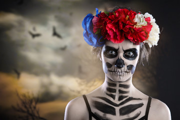 Woman art make up. Scary skull make-up for Halloween. Face-art body-art is painted, paints for body art cosmetics skin.