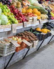 Assortment of fresh vegetables at market counter, vegetable shop