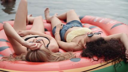 Beautiful young mixed race girls enjoying vacation by a lake.