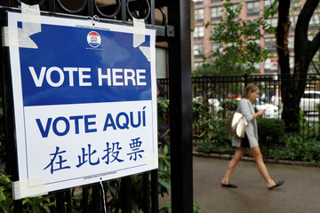 "A ""Vote Here"" sign is displayed outside a polling site during the New York State Democratic primary in New York"