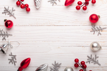 Silver and red christmas gifts on white wooden background. Top view. Copy space.