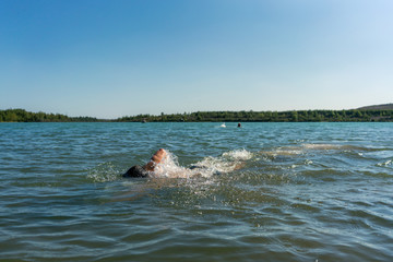 Man swimming in the Störmthaler Lake near Leipzig