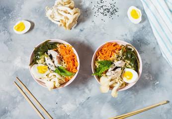 Miso Ramen Asian noodles in bowls on concrete background.