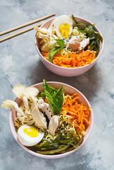 Miso Ramen Asian noodles in bowls on concrete background