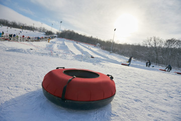 Inflatable snow tube lying on snow on winter day