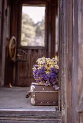 Suitcase and dried flowers
