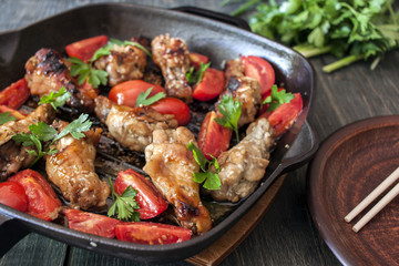 Grilled chicken wings with sesame seeds on a plate