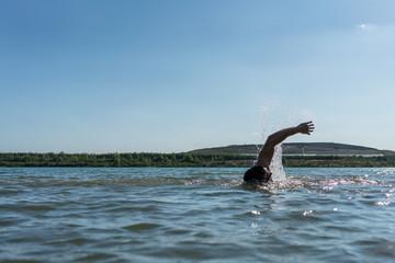Man swimming in a lake