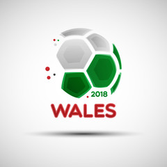 Abstract soccer ball with Welsh national flag colors