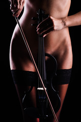 violin on the background of a beautiful naked female body