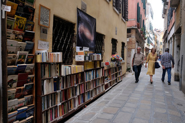 "Books are piled up in the street outside the ""Acqua Alta"" bookstore in Venice"