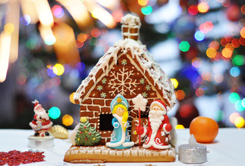 christmas gingerbread house with bright  bokeh background