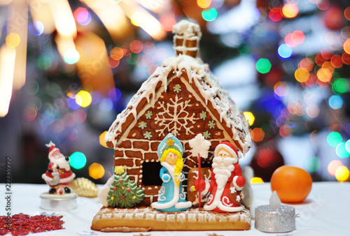 Christmas Gingerbread House Background.Christmas Gingerbread House With Bright Bokeh Background