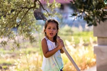 Little Girl gardening at home