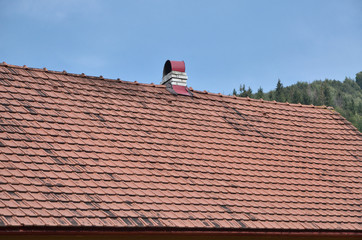 The roof of this square ceramic tile is red. The old type of roof covering in rich houses of the 19th century