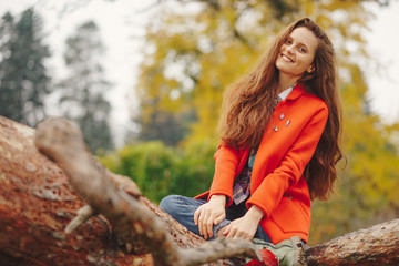 Smiling girl autumn portrait.