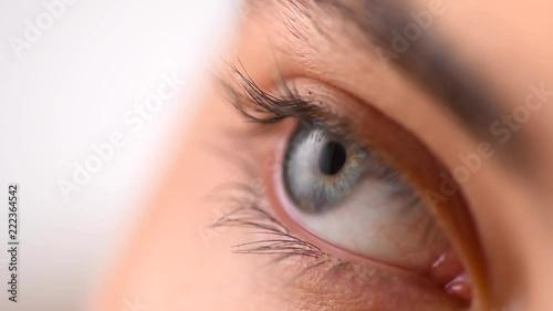 Beautiful female blue eye closeup  Young woman eye blinking