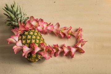 Hawaiian pineapple and fresh pink flower lei