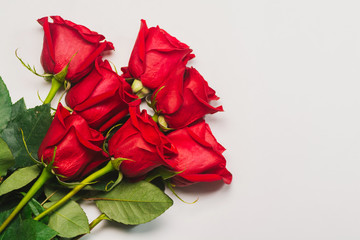 Bunch of red roses on white background. Flat lay