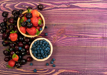 Fresh Berries on Rustic Wooden Background for Design Montage or Layout