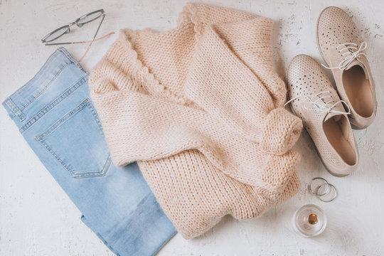 Autumn Arrives. Women fashion cloth and accessories. Trendy Cozy Jumper. Vanilla Pastel colors.