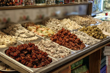 Different kinds of delicious sweets at market