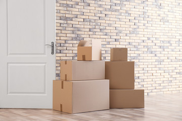 Pile of moving boxes in empty room