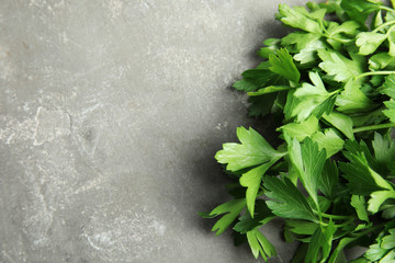 Fresh green parsley and space for text on grey background, closeup