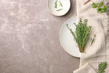 Flat lay composition with thyme, rosemary, mint and space for text on table