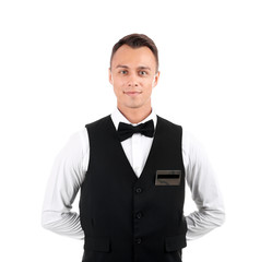 Portrait of young waiter in uniform on white background