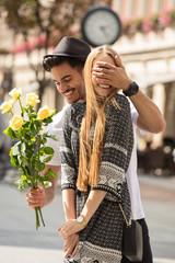 Beautiful couple with flowers dating.