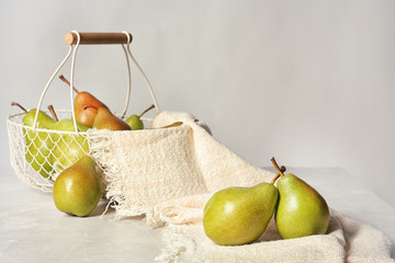 Composition with tasty ripe pears on table