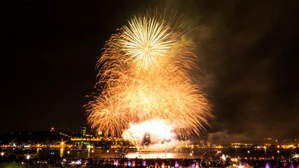 Golden fireworks during a summer festival in Quebec City, Canada.