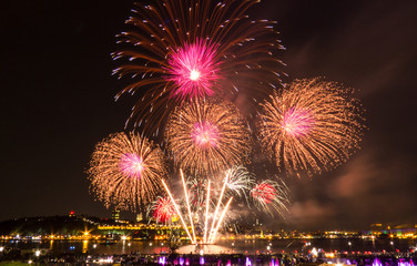 Golden, pink, and white fireworks during a summer festival in Quebec City, Canada.