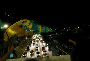 A supporter of presidential candidate Marina Silva of the Brazilian Sustainability Network Party (REDE) waves a flag during a rally in Brasilia