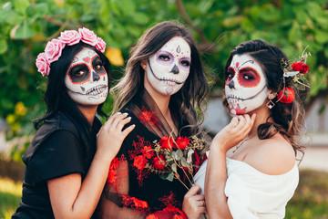 Portrait of Calavera Catrina. Young women with sugar skull makeup. Dia de los muertos. Day of The Dead. Halloween.