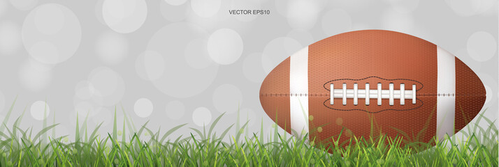 American football ball with background of green grass field and light blurred bokeh. Vector.