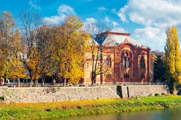 Uzhgorod, Ukraine - NOV 10, 2012: Philharmonic Orchestra Concert Hall on the bank of the river Uzh in autumn. former building of synagogue is a popular tourist attraction.