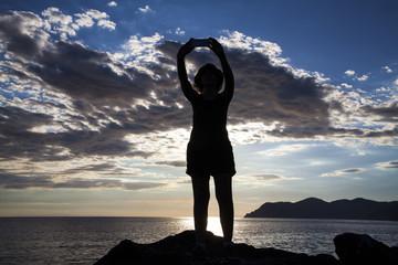 Woman taking selfie in sunset