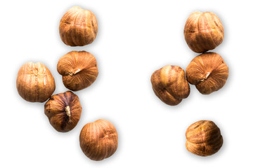 Hazelnuts isolated on white background. Creative concept of health and wellness. Nuts. Top view