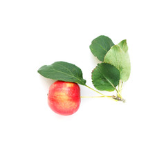 Fototapete - Red apple with green leaves isolated on white background top view.